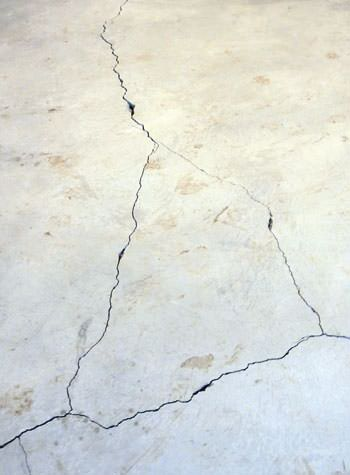 severely cracked, heaving slab floors in a home in Amherst