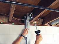 Straightening a foundation wall with the PowerBrace™ i-beam system in a Dorcester home.